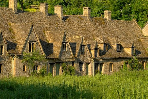 Stock photo of the medieval almshouses of Arlington Row, at Bibury, Gloucestershire Cotswolds. Part of the UK Travel and Heritage Image Library from Britain Express, Cotswold Collection