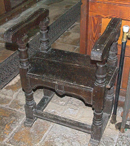 Near the south door is this simple 16th century priest's chair of darkened oak