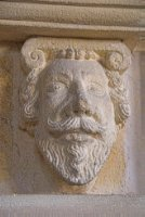 Carved head on the tomb of John Barnarde, d. 1621