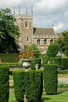 The formal gardens and Belton church