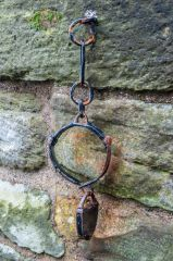 Shackles hung on the tower wall