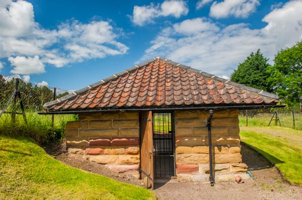 Aldborough Roman Site photo, One of the huts protecting mosaic floors