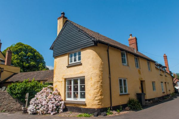 Allerford photo, An attractive cottage opposite the bridge