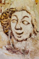 Medieval wall painting of a face
