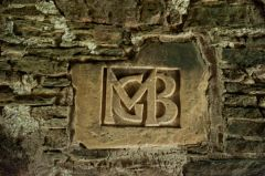 Initials above fireplace
