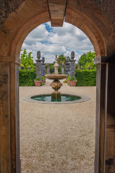 Arundel Castle photo, A garden arch and fountain