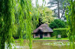 The thatched Skating Hut by the Lily Pond