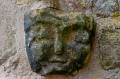 Astbury, St Mary's Church, Carved head on the church exterior
