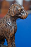 Dog carving bench end