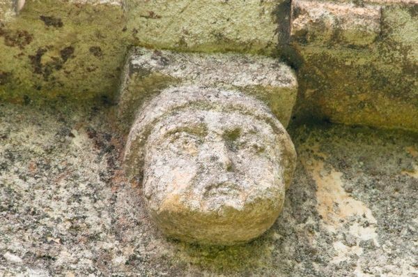Barfreston, St Nicholas Church photo, Carved face 2