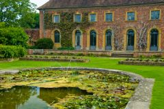 Barrington Court, A lovely lily pond stands before the old stable block