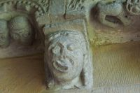 Carved head in porch