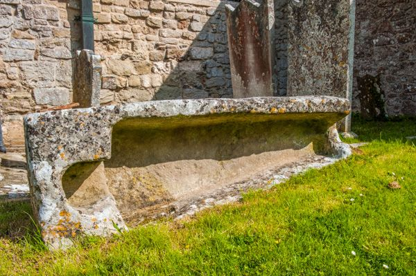 Branscombe, St Winifred's Church photo, A stone coffin outside the porch