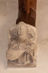 Corbel of a musician