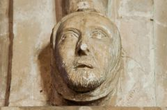 Carved head on nave column