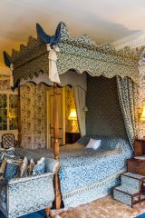 A four-poster bed in the first floor bedrooms