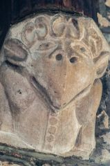 An amusing carved corbel head