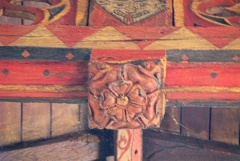 Painted Tudor rose roof boss