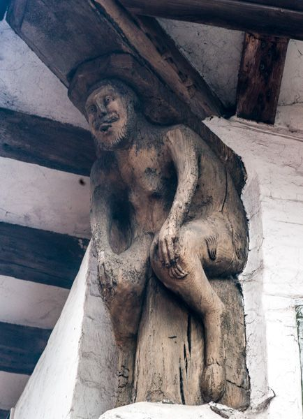 Bull House photo, Carved wooden figure on the house exterior