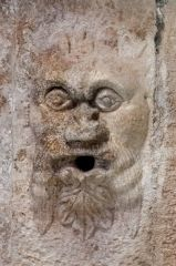 Grotesque carved face on the ceiling