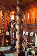 An ornately carved oak pillar