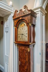 A long case clock on the first floor landing