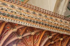 The ornate carved and painted frieze on the rood sceen