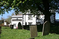 The churchyard and pub (c) Tony Atkin