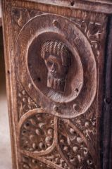 Late medieval bench end carving