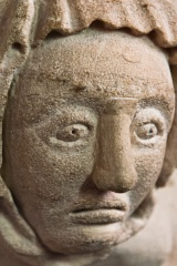 Medieval carved head, chancel