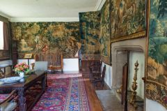 Tapestries line the walls of Cotehele