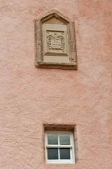 The family coat of arms on the castle exterior