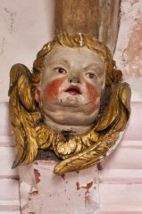 Painted angel head in the chancel