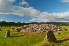 Another view of the standing stones and cairn