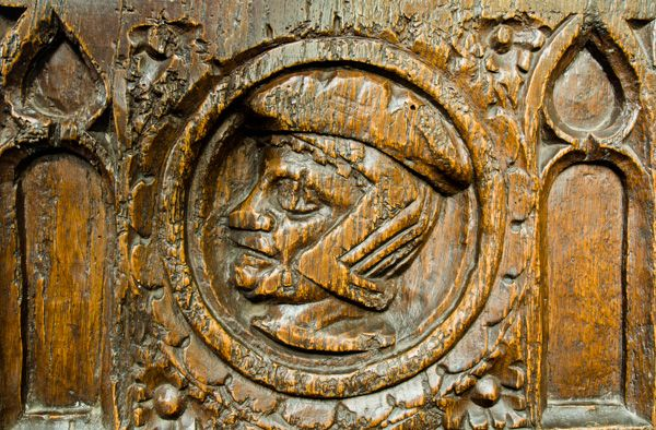 Curry Rivel, St Andrew's Church photo, Carved head of a man on a bench end in the nave