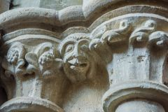 Grotesque face on a column capital