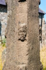 Carved head on the cross shaft