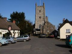 Drewsteignton, The Drewe Arms and Holy Trinity church (c) SJ Dowden