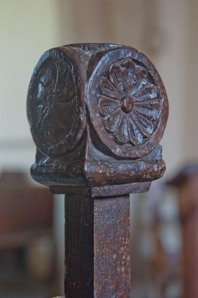 Eastleach Martin Church photo, Elizabethan bench end carving
