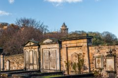 18th century graves in the kirkyard, with Calton Hill beyond