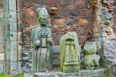 Nave statues of a bishop and knight