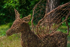 Amusing wicker sculptures dot the garden