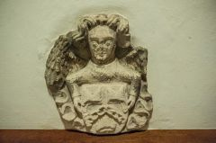 An angel holding Evesham Abbey arms