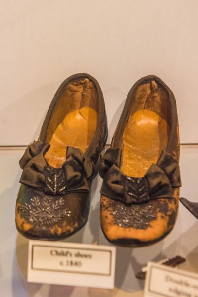 Eyam Museum photo, Victorian childrens' shoes