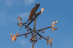 The plague rat weathervane atop the museum