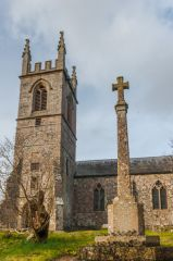 The churchyard cross and west tower
