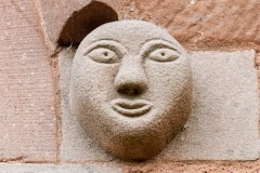 Carved head, church exterior