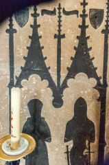 Outline of medieval brasses set on the south chapel wall