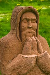 Modern sculture of a monk praying