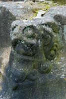 Gawsworth, St James Church, Carved head on cross base